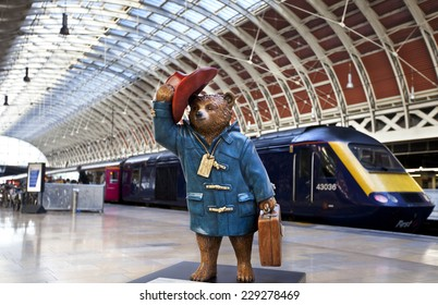 LONDON, UK - NOVEMBER 4TH 2014: A sculpture of Michael Bond's fictional children's character Paddington Bear - situated in Paddington Station in London on 4th November 2014.