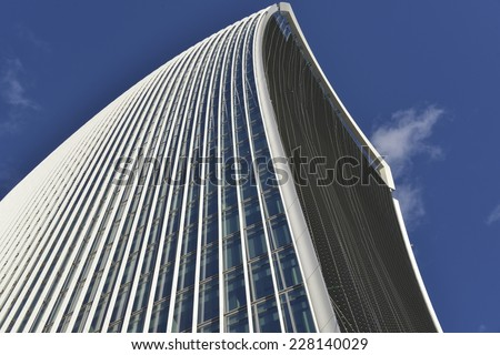 LONDON, UK - OCT 25: 20 Fenchurch Street in construction on October 25, 2014, in London, UK. Rafael Vinoly designed building (the Walkie-Talkie) with new window screens added, tenants Markel and Kiln.