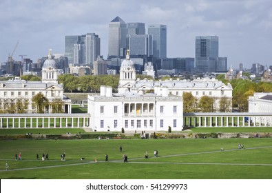 London, UK - Oct 25, 2009: The skyline of the Canary Wharf business district of London. The foreground features the Royal Naval College. Photo taken from the top of the hill at Greenwich park.