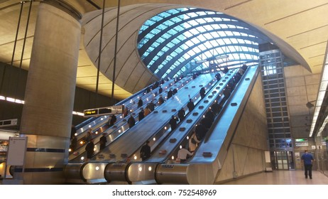 London, UK - Oct 27, 2017 - Commuters in the underground station of Canary Wharf. Canary Wharf is a new directional district built on the old docks.