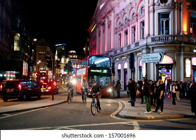 LONDON, UK - OCT 4: People stroll in Piccadilly on a Friday night in London on October 4, 2013. From pubs to upmarket bars, nightclubs and late night shopping, Piccadilly is a popular nightlife area.