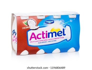 LONDON, UK - OCTOBER 05, 2018: Pack of Actimel probiotic yogurt type drink with coconut flavour. Produced by the French company Danone