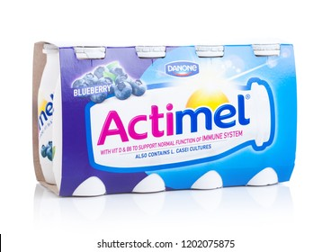 LONDON, UK - OCTOBER 05, 2018: Pack of Actimel probiotic yogurt type drink with blueberry flavour. Produced by the French company Danone