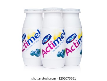 LONDON, UK - OCTOBER 05, 2018: Bottles of Actimel probiotic yogurt type drink with blueberry flavour. Produced by the French company Danone