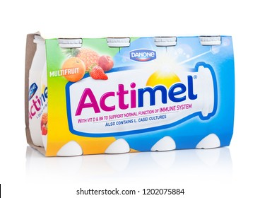 LONDON, UK - OCTOBER 05, 2018: Pack of Actimel probiotic yogurt type drink with tropical fruits flavour. Produced by the French company Danone
