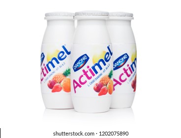 LONDON, UK - OCTOBER 05, 2018: Bottles of Actimel probiotic yogurt type drink with tropical fruits flavour. Produced by the French company Danone