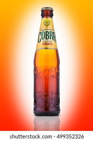 LONDON, UK - OCTOBER 06, 2016: Cobra Premium beer on a orange background, Cobra 5.0% Premium Beer is brewed to an authentic Indian recipe using the finest natural ingredients