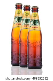 LONDON, UK - OCTOBER 06, 2016: Cobra Premium beer on a white background, Cobra 5.0% Premium Beer is brewed to an authentic Indian recipe using the finest natural ingredients