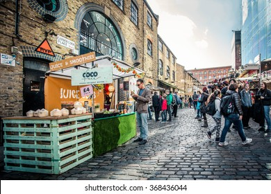 LONDON, UK - OCTOBER 10, 2014: Pictured here is a street view of historic Camden Town at the Stables  with visitors visible.