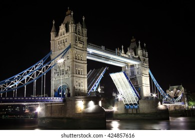 London, UK, October 13 2011 - Tower Bridge at night with its drawbridge open on the River Thames