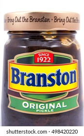 LONDON, UK - OCTOBER 13TH 2016: A close-up shot of a jar of Branston Pickle over a plain white background, on 13th October 2016.  The Branston food brand is now owned by Japanese company Mizkan.