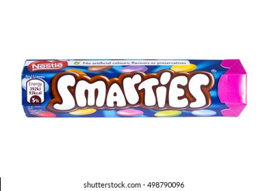 LONDON, UK - OCTOBER 13TH 2016: An unopened Smarties chocolate sweets tube manufactured by Nestle, pictured over a plain white background on 13th October 2016.