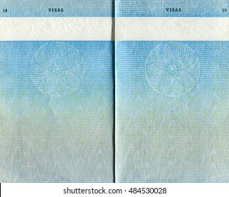 LONDON, UK - OCTOBER 14, 2014: Pages for visas marks in the old British Passport as background