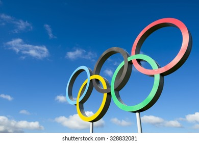 LONDON, UK - OCTOBER 14, 2015: Olympic rings stand under bright blue sky in the Queen Elizabeth Olympic Park.