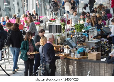 LONDON, UK - OCTOBER 14, 2015 - People in the Sky Garden cafe, relaxing and chatting