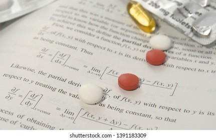 London, UK - October 15 2015: Modafinil smart drug pills on engineering books. Modafinil is a prescription drug used to treat narcolepsy and as a cognitive enhancer.