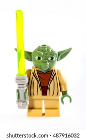 LONDON, UK - OCTOBER 15TH 2015: A Lego minifigure toy of Star Wars character Yoda over a plain white background, on 15th October 2015.