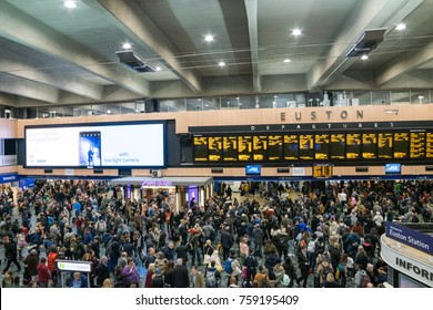 LONDON, UK - October 17th, 2017: Travelers watching the information departure boards for their gate number at the very busy Euston Railway Station.