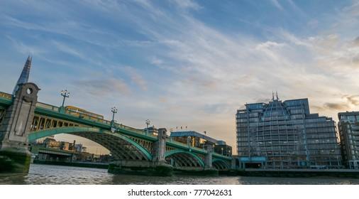LONDON, UK - October 17th, 2017: London Southwark bridge in Thames river UK.