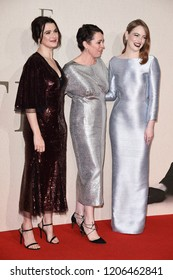 """LONDON, UK. October 18, 2018: Rachel Weisz, Olivia Colman and Emma Stone at the London Film Festival screening of """"The Favourite"""" at the BFI South Bank, London."""