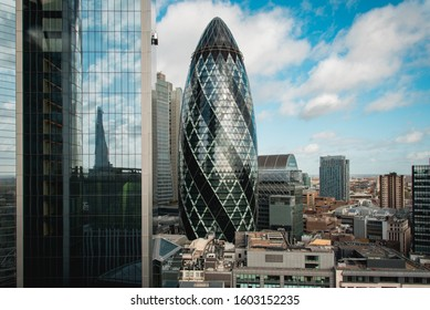 London, UK - October 18, 2019: View of buildings of London with the famous 30 St Mary Axe Building, also known as the Gherkin, in the center of the image.