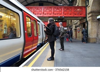 London, UK - October 18: Passenger waiting for a train on Paddington underground station in the city of Westminster on October 18, 2015 in London, UK.