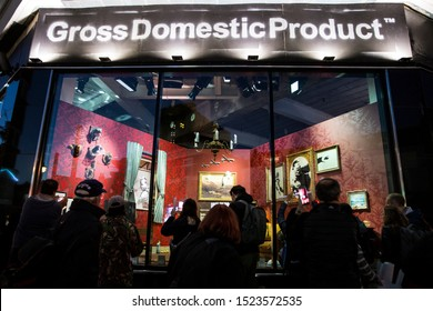 London, UK - October 2, 2019: Crowds looking at the art on display by Banksy at the street artist's Gross Domestic Product temporary showroom in Croydon, South London.