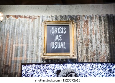London, UK - October 2, 2019: Crisis As Usual frame, Art on display by Banksy at the street artist's Gross Domestic Product temporary showroom in Croydon, South London.