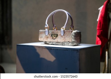 London, UK - October 2, 2019: Clutch Bag, Art on display by Banksy at the street artist's Gross Domestic Product temporary showroom in Croydon, South London.