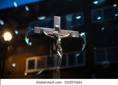London, UK - October 2, 2019: Crucifix; Art on display by Banksy at the street artist's Gross Domestic Product temporary showroom in Croydon, South London.