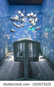 """London, UK - October 2, 2019: Baby Mobile, Art on display by Banksy at the street artist's Gross Domestic Product temporary showroom in Croydon, South London. Detail of the CCTV """"toy""""."""