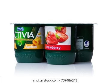 LONDON, UK - OCTOBER 20, 2017: Pack of Activia yogurt with apricot and strawberry on white background. Activia is a brand of yogurt owned by Groupe Danone.