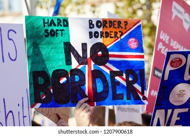 London, UK. - October 20, 2018: A placard critical of Brexit and a potential Northern Irish border is held aloft at the People's Vote march.