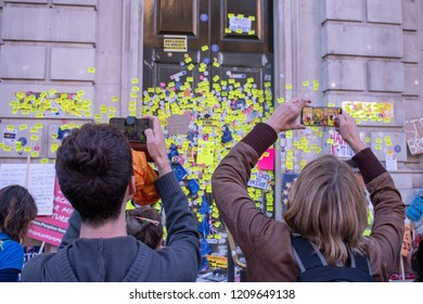 London, UK - October 20, 2018 - Protesters at the People's Vote march taking photos of Prime Minister's Office door