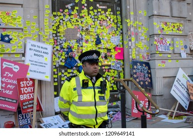 London, UK - October 20, 2018 - Police officer standing in front of Prime Ministry's Office at the People's Vote march