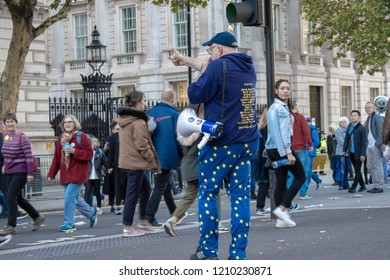 London, UK - October 20, 2018 - Man wearing EU flag pants is carrying megaphone at the People's Vote march