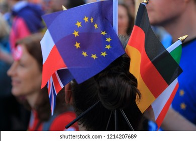 London, UK - October 20, 2018: Flags of European countries attached to girls twisted topknot