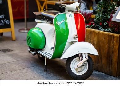 London, UK - October 20, 2018: Vintage Vespa Scooter parked on London Street