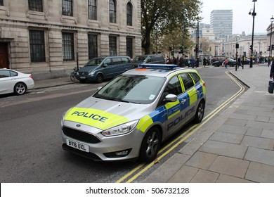 London, UK October 2016 - A silver London Metropolitan Police car is parked near Trafalgar Square while officers respond to a nearby incident