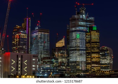 London, UK; October 2018; Aerial view of skyscrapers of the world famous bank district of central London at night