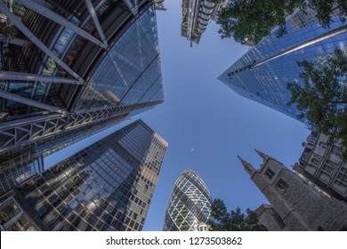 London, UK - October 2018: Looking directly up at the skyline of the financial district in central London, Lloyds of London, Gherkin, cheese grater, Leadenhall Building, Willis towers Watson, Scalpel