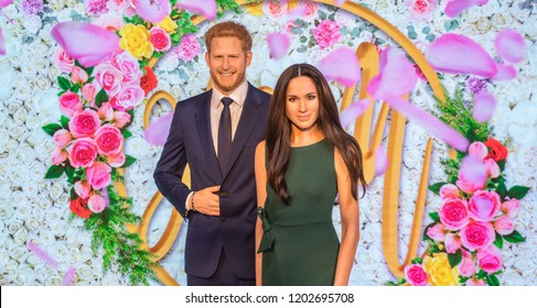 London, UK - October 2018: Madame Tussaud's Waxwork Museum, Prince Harry and Meghan Markle Realistic lifelike model