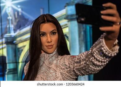 London, UK - October 2018: Madame Tussaud's Waxwork Museum, Kim Kardashian, realistic lifelike model taking a selfie