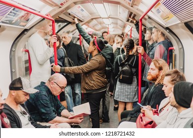 London, UK - October 21st, 2018; Random people travelling by underground train on the Central Line, TFL.