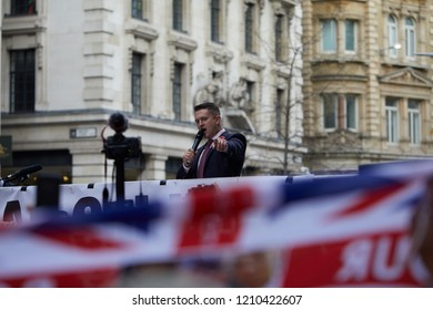 London, UK. - October 23, 2018: Tommy Robinson points at a group of reporters whist addressing  a crowd of supporters about media bias outside the Old Bailey.