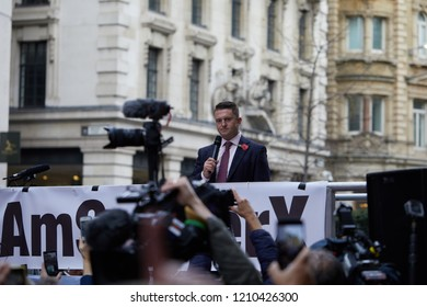 London, UK. - October 23, 2018: Tommy Robinson looks disapproving at a group of reporters whist addressing  a crowd of supporters outside the Old Bailey.