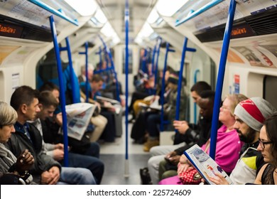 London, UK - October 24, 2014: Commuters sitting on a busy and crowded Victoria Line underground train. London Tube subway carried a record 1.26 billion passengers in the 2013-2014 year.