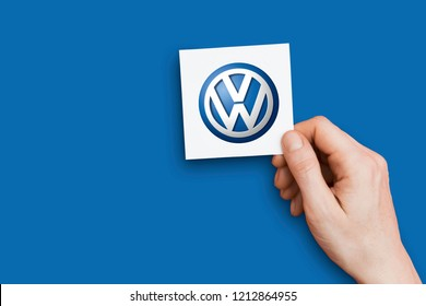 LONDON, UK - October 26th 2018: Hand holding an volkswagen logo. volkswagen is an automobile manufacturer.