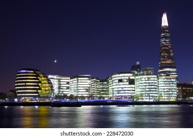 LONDON, UK - OCTOBER 27TH 2014: A view at dusk of the modern buildings along the South Bank of the River Thames in London on 27th October 2014.  The buildings include the Shard and City Hall.