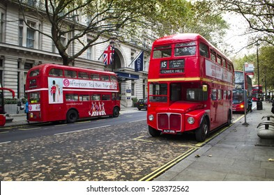 LONDON, UK - OCTOBER 28, 2016: One Londoner red double decker vintage bus and some new buses in a street.